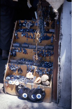 Market stall selling blue glass Evil Eye amulets, Istanbul, Turkey